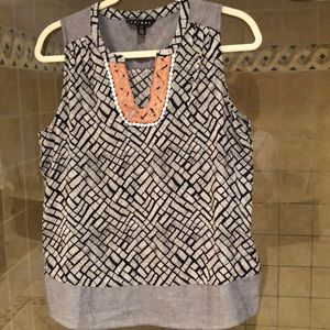 Patterned cotton tank with embroidered detail.